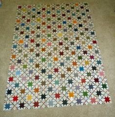 "Sue Garman - Awesome as always. The stars are 4-1/2"" finished size, and the small double-9-patch squares are 1/2"" finished.  Wow!"