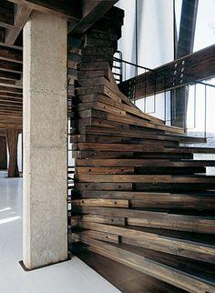 Stunning wooden, spiral staircase.