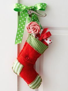 Doorknob Stockings:   These stuffed stocking gifts double as decorations when you dangle them from bedroom doors. Simply loop a length of patterned ribbon through a purchased  stocking, and tie the ends of the ribbon into a bow to fashion a pretty hanger. Stuff the stocking with your favorite sweet treats and mini gift-wrapped boxes.