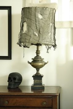 Draped webbing on lamps with black cheesecloth