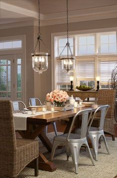 Farmhouse Style Dining Room with Beautiful Lighting!