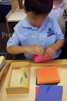 sorting paper by colour and using paper clips