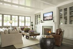 coffee tables, beadboard ceiling with beams, beadboard living room, famili room, family rooms, casual famili, fireplace built ins, live room, built in cabinets over door