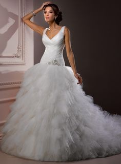 Straps Dropped waist Ball Gown Tulle wedding dress. I LOVE the top of this dress