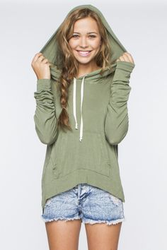 oversized light green hooded pullover sweatshirt with ripped jean shorts