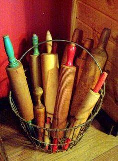 Basket of vintage rolling pins