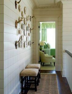 shiplap antler, white walls, plank walls, white bedrooms, wall plates, upstairs hallway, green rooms, wood walls, wall arrangements
