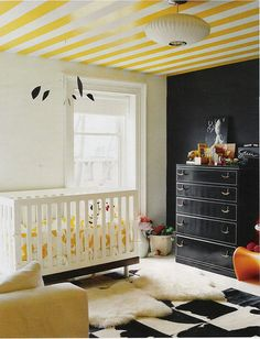 yellow stripes.  I've always decorated the ceiling in my children's rooms.  It adds so much.  This is a beautiful room.  Not sure I'm cool enough for the black wall though...