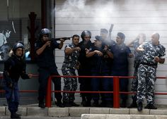 Lebanese security forces fire shots to disperse men ransacking US fast food chains as they protest the video in Tripoli on September 14, 2012. (AFP/Getty Images)