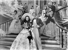 The cast of Gone with the Wind on the grand staircase of Tara