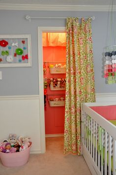 We love a painted closet! And the curtain adds a fun pop of color and patter. #nurserydecor