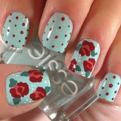 californails:  Vintage Floral Mani I love floral manis right now! In this one I'm using my new Essie polish that might be my new favorite. What I used: • Mint Candy Apple by Essie • Your Hut or Mine by Essie • Radiant Red by Sally Hansen (Check this out on Instagram!)
