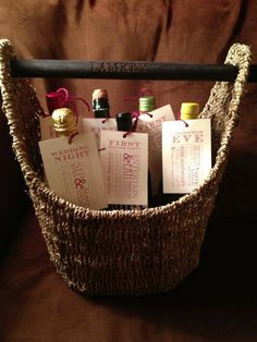 Wedding, house warming or anytime gift - wine in a ThirtyOne magazine basket with the family name on the handle.
