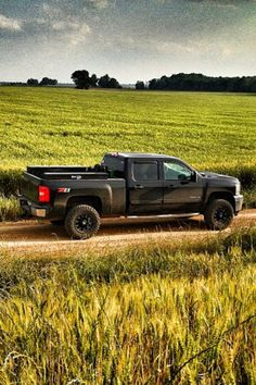 Chevy Silverado 2500HD z71 4x4 leveled, parked on a dirt road in the fields.