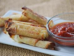 Mozzarella Sticks.  Wrap string cheese in wonton wrapper that has been brushed with a little oil and lightly salted.  Bake 400 deg. 15 min., turn and bake 5 min. more.  Serve with marinara, ranch dressing, guacamole or salsa.