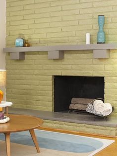What did you think of the avocado-green paint color used on the fireplace? Head to the HGTVersus blog and watch the behind-the-scenes video the see what Jonathan and Drew thought of Brett's design decision. (http://blog.hgtv.com/HGTVersus/2013/07/29/brother-vs-brother-inside-episode-two/?soc=Pinterest)