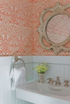 Small Spaces with Wonderful Wallpaper from apartment therapy. Love this color, pattern, and coordinating mirror