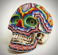 Skulls Hand Covered in Vibrant Beads