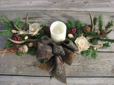 Camo Deer Antler Candle Centerpiece Camo Wedding by TheVineDesigns, $85.00 https://www.etsy.com/listing/174316287/camo-deer-antler-candle-centerpiece-camo?ref=teams_post