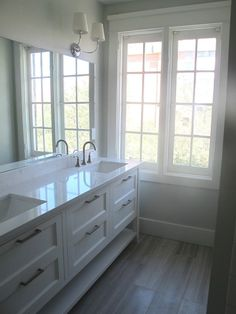 Gorgeous bathroom with limestone tiles floor from Daltile (looks like wood), creamy white double bathroom vanity painted benjamin Moore White Dove, Thomas O'Brien Vendome Double Sconce and Cambria Torquay Quartz countertops (looks just like marble).   Benjamin MooreWhite Dove