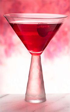 Love Potion (2 ounces cranberry juice cocktail   1 ounce Absolut Raspberry   Splash sweetened lime juice   Splash grenadine   Raspberry for garnish)