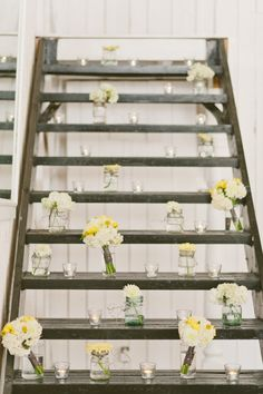 arrange flowers in jars and vases on unused stairs // photo by TaraMcMullen.com