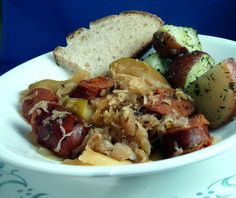 Whats for dinner tonight..except I use chicken stock instead of apple juice, only one apple and no sugar.  It's yum!  Polish Sauerkraut and Apples. Photo by PaulaG