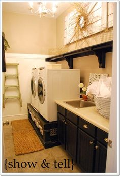 Art Wow...what a pretty laundry room.  Love the basket holders under the washer and dryer! home