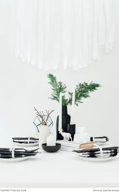 Simplistic, monochrome Christmas table decor ideas | See the full shoot on theprettyblog.com | Plastic Black Cutlery Set: In Good Company | Vases: Country Road | Glass Terrarium: Typo | Photography: Christine Meintjes | Styling: Lydia vd Spuy & Christine Meintjes from The Pretty Blog |