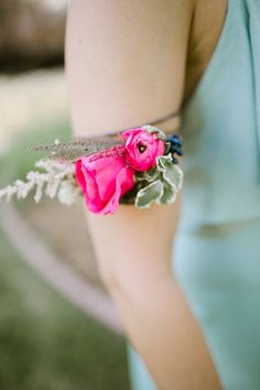 floral arm band for the bridesmaids, photo by Our Love is Loud http://ruffledblog.com/river-bend-colorado-wedding #weddingideas #bridesmaid #flowers