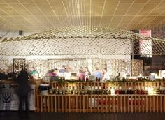 Pickles & Chutney Slow Foods Pavilion - over 3000 mason jar lids suspended from the ceiling