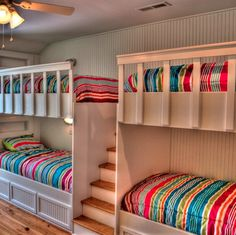 This cozy kids' room has space for four thanks to custom built-in bunks in a sleeping alcove.