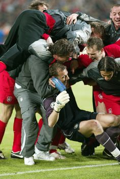 Jerzy Dudek is mobbed by his team-mates