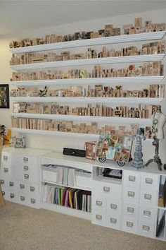 This site has neat organization ideas for my craft room. I wish I could do a wall like this but I have too many stamps:) scraproom, stamp storage, room storage, storage ideas, organization ideas, craft studios, scrap room, getting organized, craft rooms
