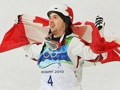 Canadian Alexandre Bilodeau from Montreal, Que., celebrates his gold medal during the freestyle skiing, men's moguls event at Cypress Mountain in West Vancouver, B.C., on Sunday, Feb. 14