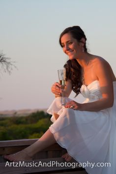 Heather, having a toast with friends, just after her wedding on Hatteras Island, NC
