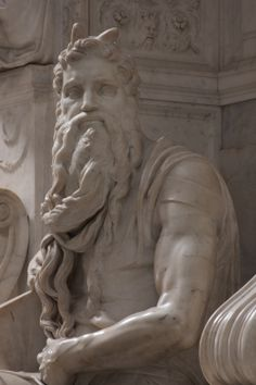 Moses - St. Peter in Chains (San Pietro in Vincoli) Rome, Italy - Michelangelo sculpted this figure 1513 -1515. Are therehorns on his head? It was the way Moses was depicted then.