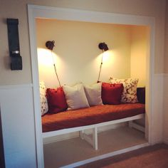 Closet turned into reading nook.  MINT DESIGN