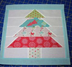 Christmas tree quilt block tutorial. A whole throw quilt of these with appliqued ornaments and cheery green, red, or peppermint binding?