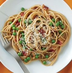 Bacon and eggs and peas and pasta. Spaghetti Carbonara with Peas is our (lighter) take on an Italian classic. So delicious!