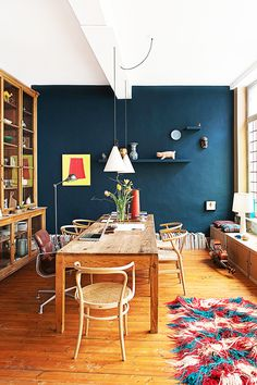 Tour a Belgian Townhouse With Bohemian Flair // dining room, bookcase, bentwood chair, farmhouse table, records, violin