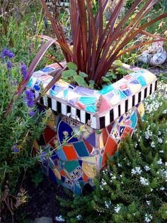 Mosaic plant pot from recycled chimney
