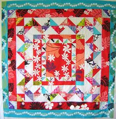 Quiltopia! Design: Quilt top made in Pacific Island fabrics; a variation on the Bird of Paradise design by Ann Ferguson