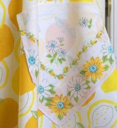 Repurpose a vintage hankie as a pocket on an apron