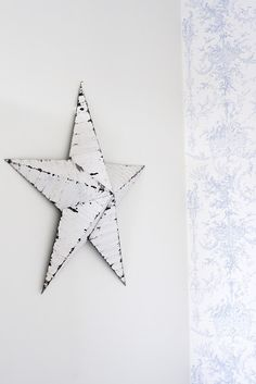 white shabby star above a bed