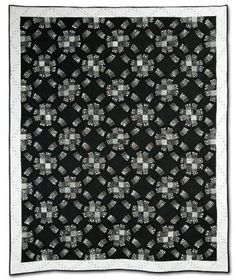 "Black and white double wedding ring quilt, 65"" x 77"",  by Ann Plutzer at Empire Quilters.  Hand pieced and hand quilted."