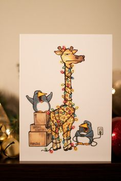 Giraffe and penguins with holiday lights! LOVE it!