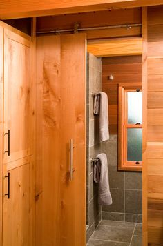 Sliding doors save space in a small bathroom