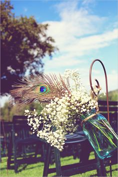 mason jar with peacock and babys breath