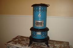 Love this Vintage Metal Blue Home Decor Perfection Smokeless Oil Heater.  Can be used outside, in a bathroom, or even as a plant stand.